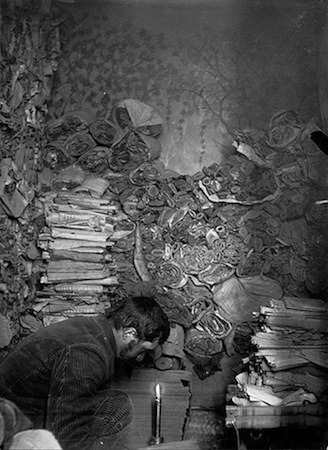 Paul Pelliot working in the library cave in 1908