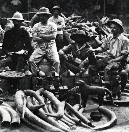 British soldiers sit surrounded by Benin works of art during the British Punitive Expedition of 1897 (documentary photograph, Rawson, Sir Harry Holdsworth, 1897)