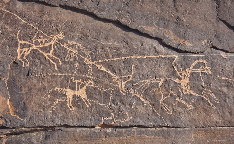 "Rock engraving depicting an ostrich hunt: ""Wadi Uqla horsemen and ostrich,"" Tayma oasis site in northwestern Saudi Arabia"