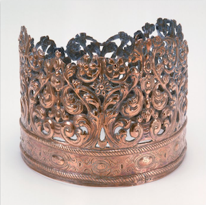 "Torah Crown, 1698-99, Bolzano, Italy (The Jewish Museum, New York) ""Originally dedicated to an Italian synagogue in 1698/99, this crown was later plundered during a Russian pogrom and then recovered. It became part of the collection of the Great Synagogue of Danzig in the early 20th century. In 1939, it was sent to the Jewish Theological seminary in New York for safekeeping when the Nazis' rise to power forced the Danzig Jewish community to disband."" Source"