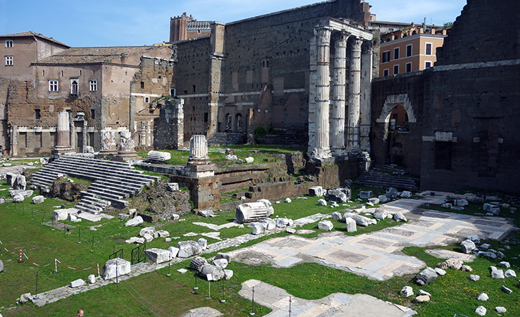View of the ruins of the Temple of Mars Ultor in the Forum Augusti, c. 2 B.C.E.; the stairs to the temple platform are visible (left) and the paving stones of one portico can be seen at the lower right