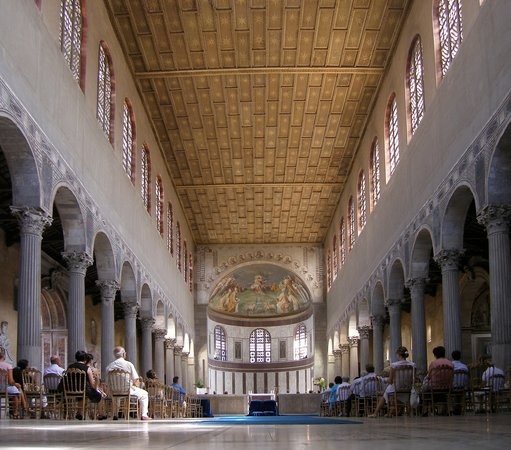 View of the nave, looking toward the apse—the row of windows above the nave arcade is called the clerestory and we see an aisle on either side of the nave. Interior of Santa Sabina, an early Roman Christian church, 422-432 C.E. (photo: Dnalor 01, CC BY-SA 3.0)