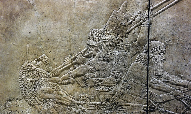 Ashurbanipal slitting the throat of a lion from his chariot (detail), Ashurbanipal Hunting Lions, gypsum hall relief from the North Palace, Ninevah, c. 645-635 B.C.E., excavated by H. Rassam beginning in 1853 (British Museum)