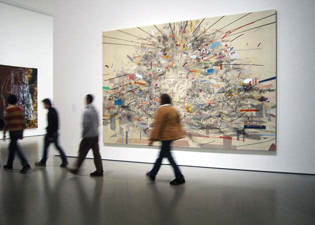Visitors at the museum of modern art in front of julie mehretu empirical construction istanbul 2003 ink and synthetic polymer paint on canvas