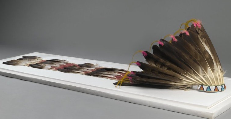 Sioux or Cheyenne Artist, Feathered War Bonnet (Pawhuska, Oklahoma), late 19th-early 20th c., feathers, beads, pigment, hide, dyed horsehair, 174 x 21.5cm (The Brooklyn Museum)