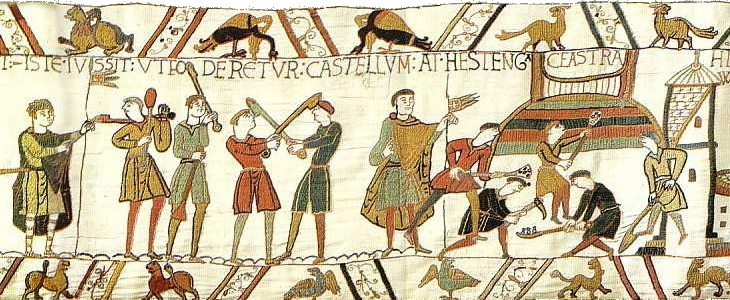 Preparations for war, including the building of a motte-and-bailey (detail), Bayeux Tapestry, c. 1070, embroidered wool on linen, 20 inches high (Bayeux Museum)