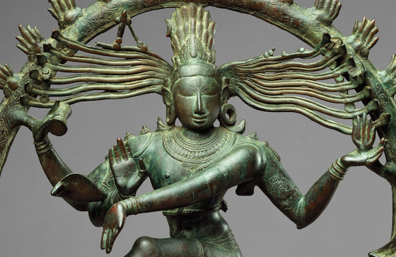 Round face, almond eyes and long arms of Shiva surrounded by circle of fire (detail), Shiva as Lord of the Dance (Nataraja), c. 11th century, Copper alloy, Chola period, 68.3 x 56.5 cm (The Metropolitan Museum of Art)