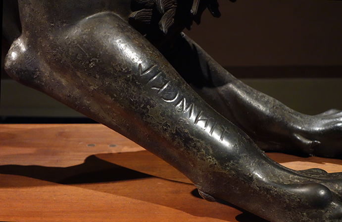 "Detail with inscription ""tinścvil"", Chimera from Arezzo,, c. 400 B.C.E., bronze, 129 cm in length, (Museo Archeologico Nazionale, Florence)"