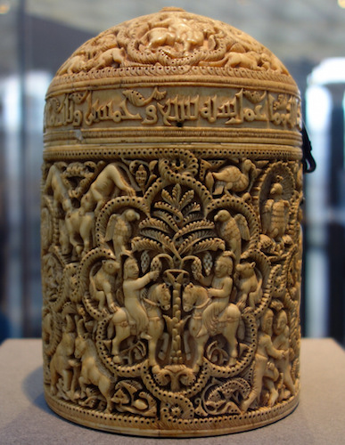 Pyxis of al-Mughira, possibly from Madinat al-Zahra, AH 357/ 968 CE, carved ivory with traces of jade, 16cm x 11.8 cm (Musée du Louvre, Paris)
