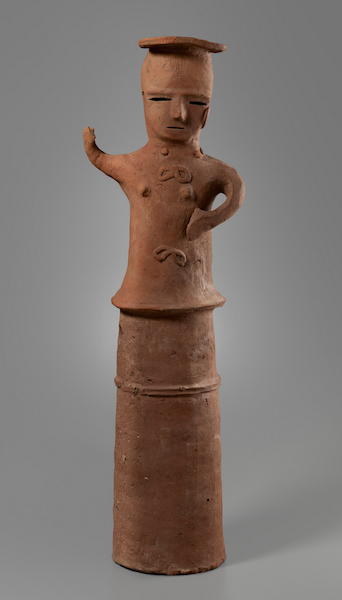 "Haniwa, standing female, 6th–7th century, reddish earthenware, 88.9 x 26.7 x 20.3 cm / 35 x 10 1/2 x 8 inches (Yale University Art Gallery) ""The round clay pieces attached to her neckline appear to be the remnant of a necklace, which suggests she could represent a miko, a maiden serving in Shinto rituals."" (source)"