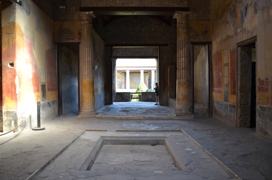 Impluvium in atrium, looking through the tablinum toward the peristyle, House of Menander, Pompeii before 79 C.E. (photo: Carole Raddato, CC BY-SA 2.0)