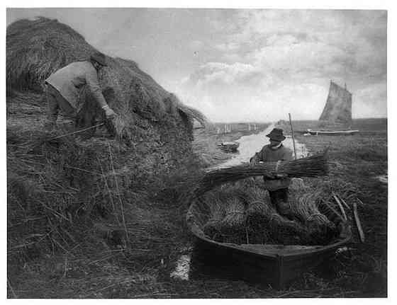 "Peter Henry Emerson, ""Ricking the Reed,"" photograph from Life and Landscape on the Norfolk Broads by P.H. Emerson and T.F. Goodall. London : Sampson Low, Marston, Searle, and Rivington, 1886"