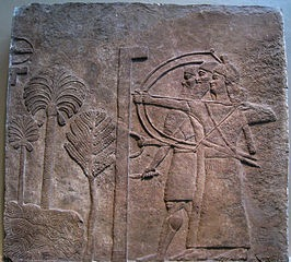 Wall relief from Nimrud, the sieging of a city, likely in Mesopotamia, c. 728 B.C.E. (British Museum)