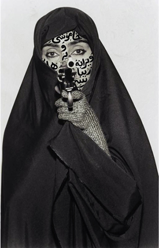 Shirin Neshat, Faceless, Women of Allah series, 1994, B&W RC print & ink, photo by Cynthia Preston ©Shirin Neshat (courtesy Barbara Gladstone Gallery, New York and Brussels)
