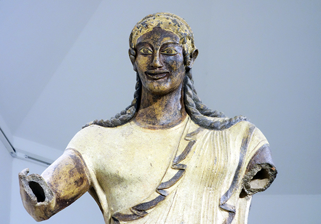 Apulu (Apollo of Veii) detail, from the roof of the Portonaccio Temple, Veii, Italy, c. 510-500 B.C.E., painted terra-cotta, 5 feet 11inches high (Museo Nazionale di Villa Giulia, Rome)