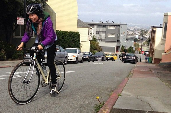 A photo of Brenda biking up the hills of San Francisco