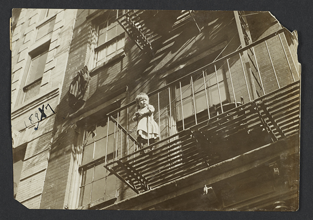 Jessie Tarbox Beals, Child on Fire Escape, c. 1918, for the New York Association for Improving the Condition of the Poor (Columbia University Libraries)
