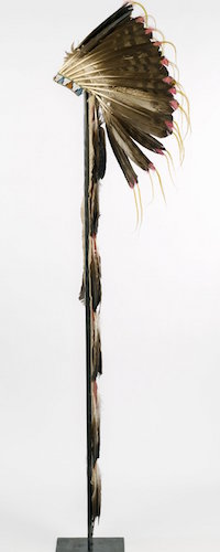 Sioux or Cheyenne Artist, Feathered War Bonnet (Pawhuska, Oklahoma), late 19th-early 20th c., feathers, beads, pigment, hide, dyed horsehair, 174 x 21.5 cm (The Brooklyn Museum)