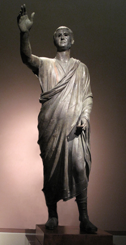 Aule Metele (Arringatore), from Cortona, Italy, early 1st century B.C.E., bronze, 67 inches high (Museo Archeologico Nazionale, Florence), (image (shadow eliminated): corneliagraco, CC BY 2.0)