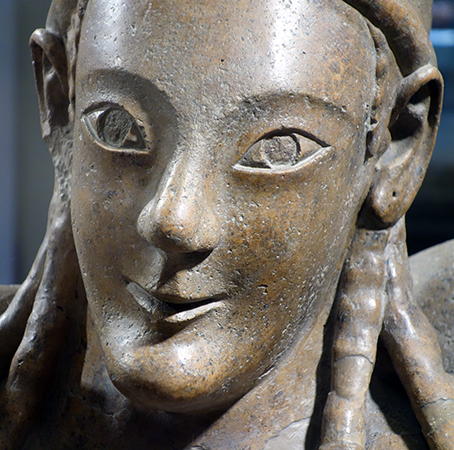 Female's face (detail), Sarcophagus of the Spouses, c. 520 B.C.E., Etruscan, painted terracotta, 3 feet 9-1/2 inches x 6 feet 7 inches, found in the Banditaccia necropolis, Cerveteri (Museo Nazionale di Villa Giulia in Rome)