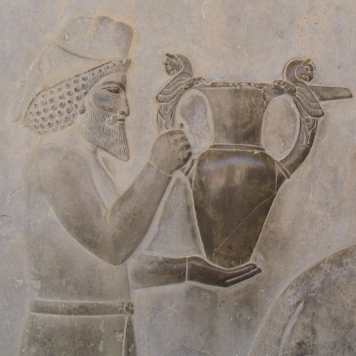 An Armenian tribute bearer carrying a metal vessel with Homa (griffin) handles, relief from the eastern stairs of the Apādana in Persepolis: (Fars. Iran), c. 520-465 B.C.E. (photo: Aryamahasattva, CC BY-SA 3.0)