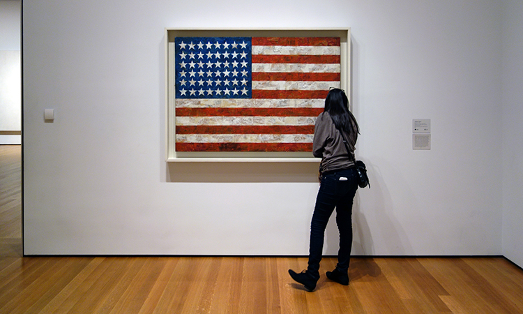 "Jasper Johns, Flag, 1954-55 (dated on reverse 1954), encaustic, oil, and collage on fabric mounted on plywood, three panels, 42-1/4 x 60-5/8"" /107.3 x 153.8 cm (The Museum of Modern Art, New York)"