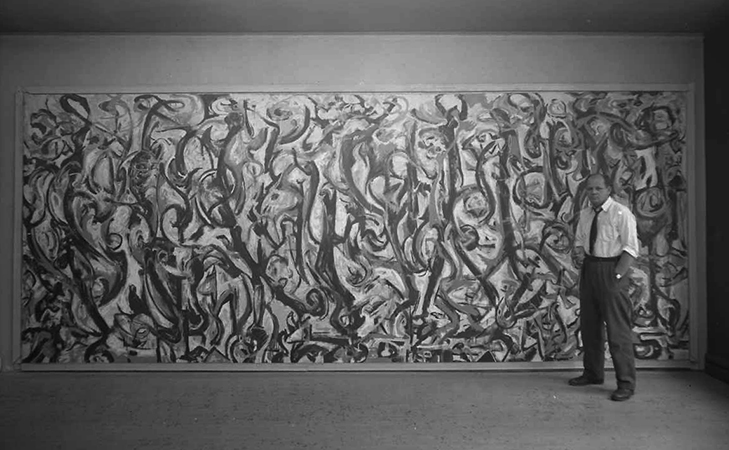 Jackson Pollock standing beside Mural at Vogue Studios © Estate of Herbert Matter. Special Collections and University Archives Department, Stanford University Libraries