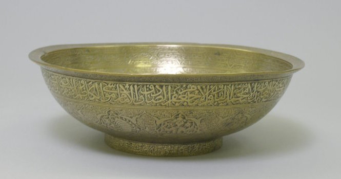 Divination Bowl with Inscriptions and Zodiac Signs, mid 16th century, copper alloy (brass), engraved with repoussé center, 3 3/4 x 8 1/2 x 8 1/2in. / 9.5 x 21.6 x 21.6cm (The Brooklyn Museum)