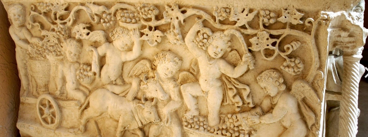 Erotes harvesting grapes from the Sarcophagus of Junius Bassus (photo adapted from: G.dallorto)