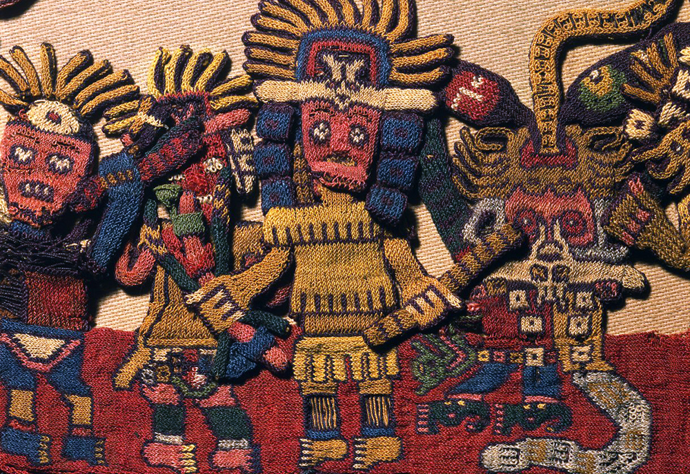 "detail of border figure 61, Nasca, Mantle (""The Paracas Textile""), 100-300 C.E., cotton, camelid fiber, 58-1/4 x 24-1/2 inches / 148 x 62.2 cm, found South Coast, Paracas, Peru (Brooklyn Museum)"