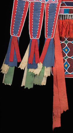 Silk ribbons (detail), Bandolier Bag, Lenape (Delaware tribe, Oklahoma), c. 1850 C.E., hide, cotton cloth, silk ribbon, glass beads, wool yarn, metal cones, 68 x 47 cm (National Museum of the American Indian, New York)