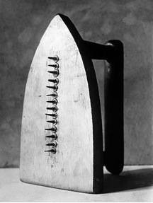 Man Ray, Gift, c. 1958 (replica of 1921 original), painted flatiron and tacks, 15.3 x 9 x 11.4 cm (The Museum of Modern Art)