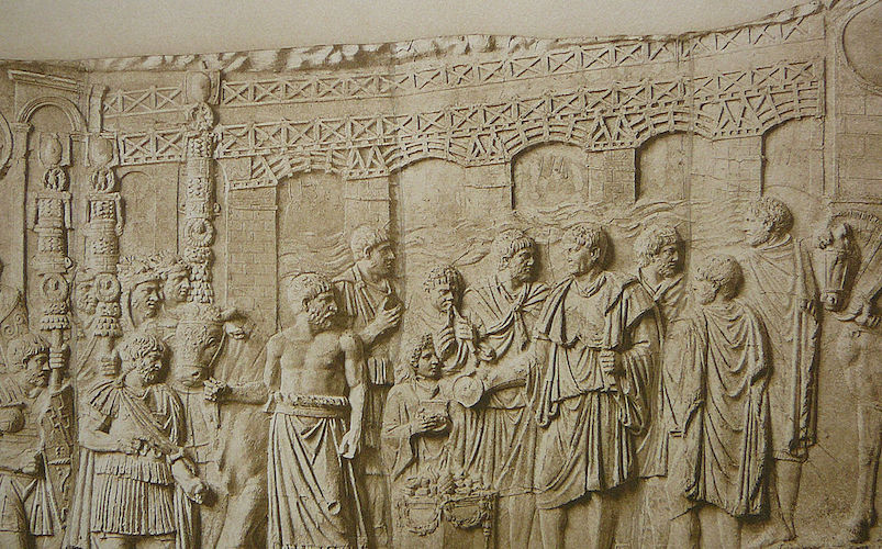 Relief from the Column of Trajan, Carrara marble, completed 113 C.E., showing the bridge in the background; in the foreground emperor Trajan sacrificing by the Danube