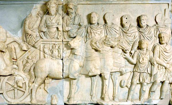 "Chariot procession of Septimus Severus, relief from the attach of the Arch of Septimus Severus, Leptis Magna, Libya, 203 C.E., marble, 5; 6"" high, Castle Museum, Tripoli"