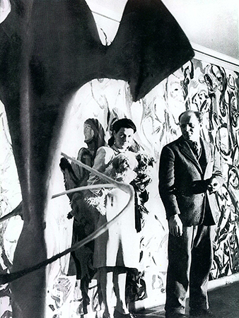 Jackson Pollock and Peggy Guggenheim in front of Mural, c. 1944, in Guggenheim's New York City  townhouse, (photo: George Carger)