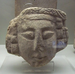Iberian female head, c.  299 and 100 BCE, sandstone, 15 cm x 17 cm x 10 cm (National Archaeological Museum of Spain)