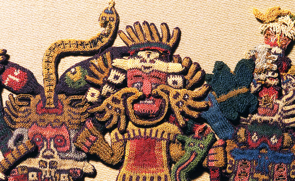 "Detail with face ornament, figure 63, Nasca, Mantle (""The Paracas Textile""), 100-300 C.E., cotton, camelid fiber, 58-1/4 x 24-1/2 inches / 148 x 62.2 cm, found South Coast, Paracas, Peru (Brooklyn Museum)"