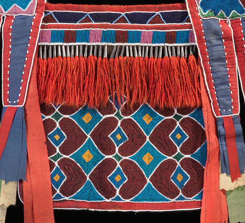 Fringe (detail), Bandolier Bag, Lenape (Delaware tribe, Oklahoma), c. 1850 C.E., hide, cotton cloth, silk ribbon, glass beads, wool yarn, metal cones, 68 x 47 cm (National Museum of the American Indian, New York)