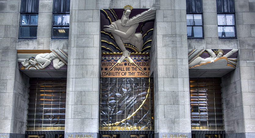 Lee Lawrie, Wisdom (center), with Light (right) and Sound (left), 1933, painted and gilded limestone, glass (photo: Terry Robinson, CC BY-SA 2.0)