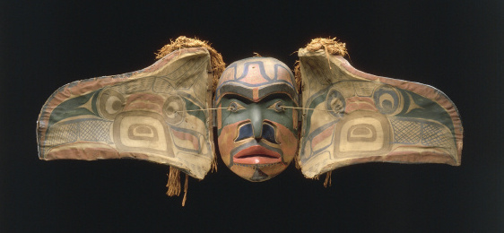 "Transformation Mask, Kwakiutl population, British Columbia, Canada, wood paint, graphite, cedar, cloth, string, 34 X 53 cm closed, 130 cm open (Quai Branly Museum). ""This transformation mask opens into two sections. Closed, it represents a crow or an eagle; when spread out, a human face appears. It was associated with initiation rites that took place during the winter. During these ceremonies, both religious and theatrical, the spirit of the ancestors was supposed to enter into men."" (source)"