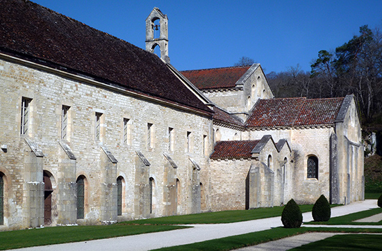 View of chapter house (below left), dormatory (above left), and church apse (right)