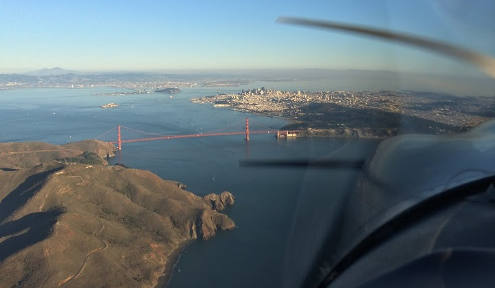 View from outside the pilot window when flying over the bay