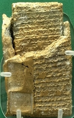 "Cuneiform tablet still in its clay case: legal case from Niqmepuh, King of Iamhad (Aleppo), 1720 B.C.E., 3.94 x 2"" (British Museum)"